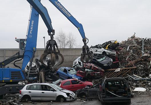 Crane and scrap cars