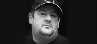 Black and white photo of Johnny Vegas
