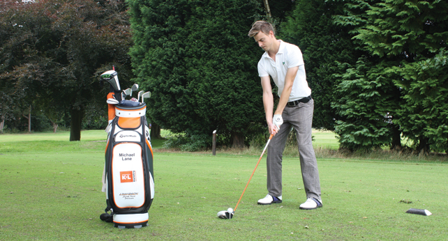 Michael Lane, golfer, preparing to take a swing of his golfclub